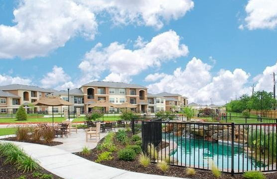 Resort-Style Pool at the Oxford at Country Club Apartments in Baytown, TX