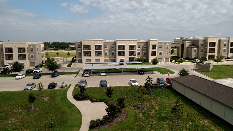 Parking Lot at Oxford at Crossroads Centre Apartments in Waxahachie, TX