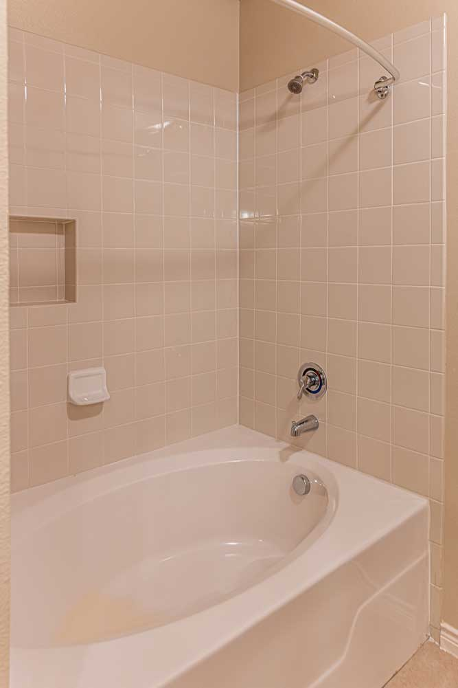 Tub and Shower at Oxford at Crossroads Centre Apartments in Waxahachie, TX