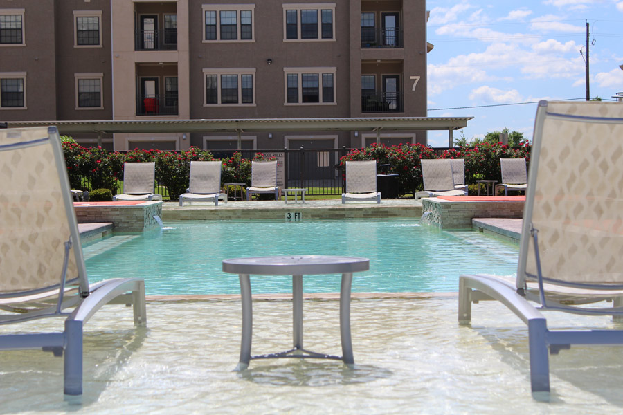 Outdoor Swimming Pool at Oxford at Crossroads Centre Apartments in Waxahachie, TX
