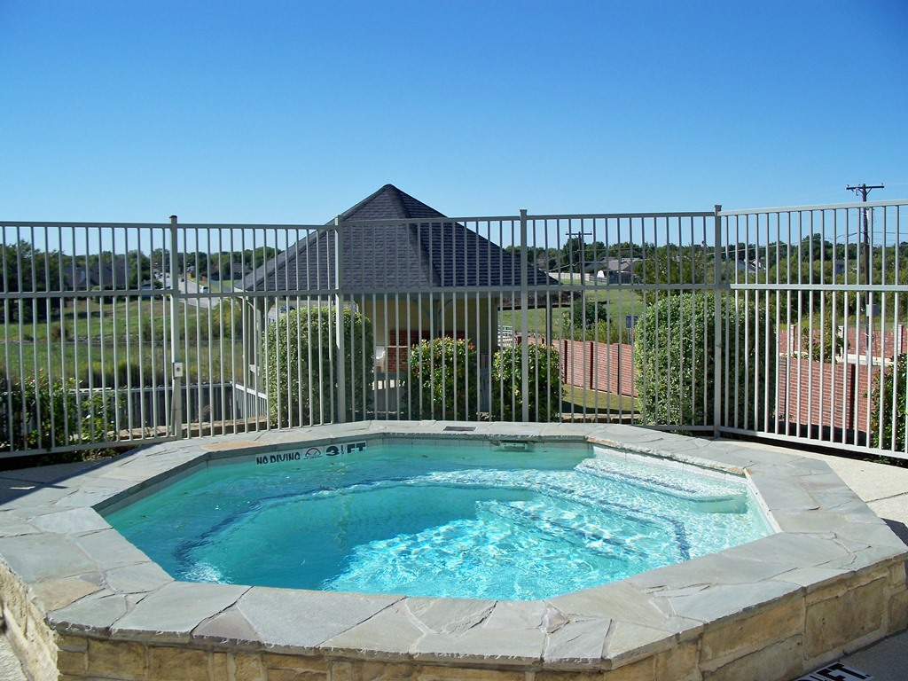 Sparkling Pool at The Oxford at Iron Horse Apartments in North Richland Hills, TX