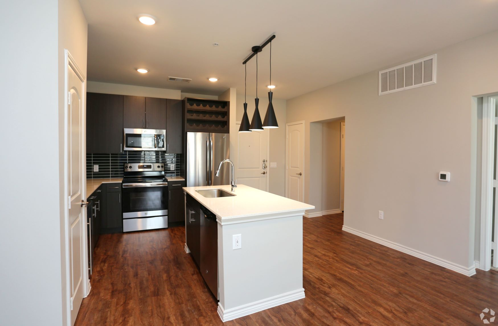 Stainless steel appliances, wine fridge, quartz countertops!