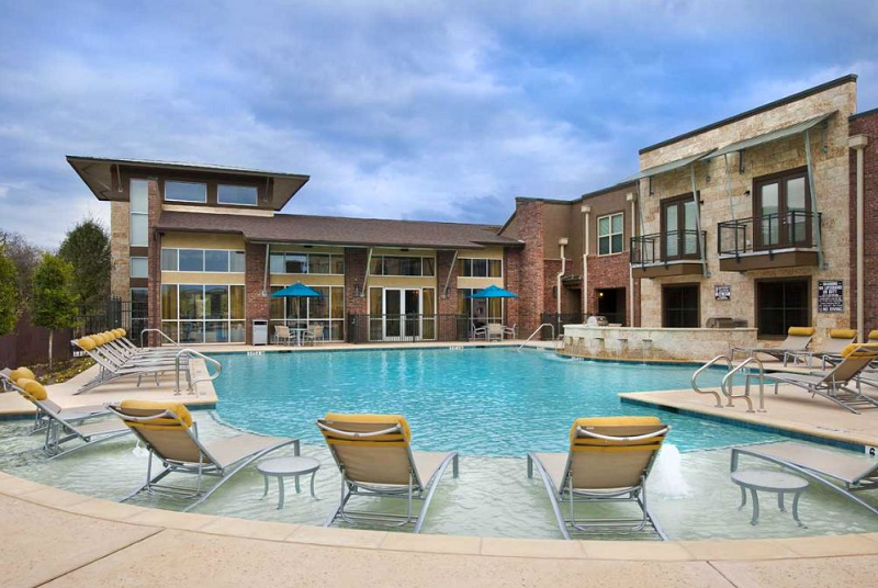 Sparkling Pool at The Oxford at The Boulevard Apartments in Corinth, TX