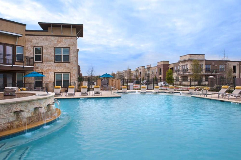Resort-Style Pool at The Oxford at The Boulevard Apartments in Corinth, TX
