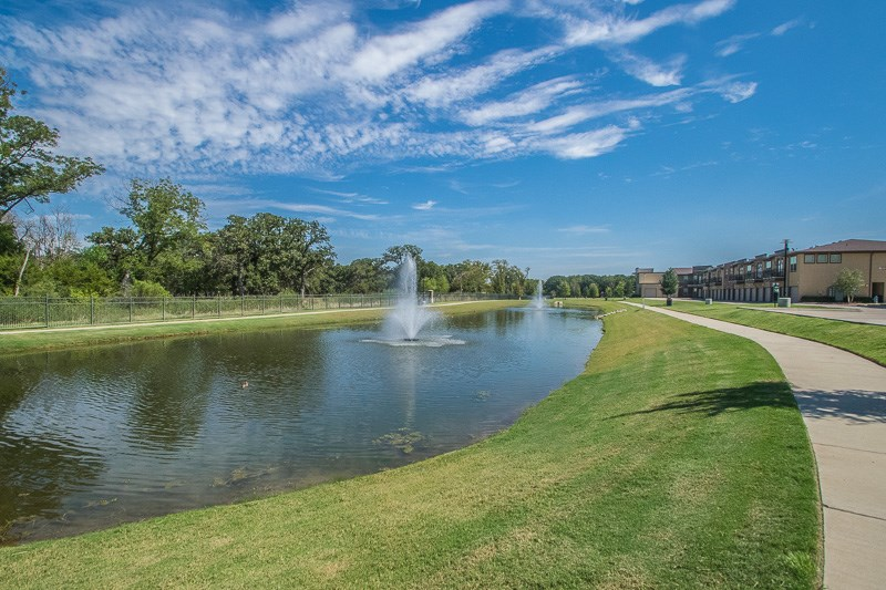Private Pond with Fountains at The Oxford at The Boulevard Apartments in Corinth, TX