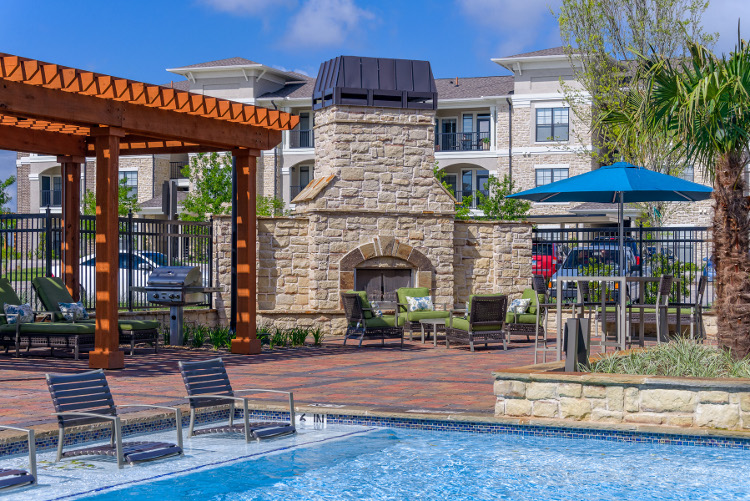 Sparkling Pool at The Heights at Harper's Preserve Apartments in Conroe, TX