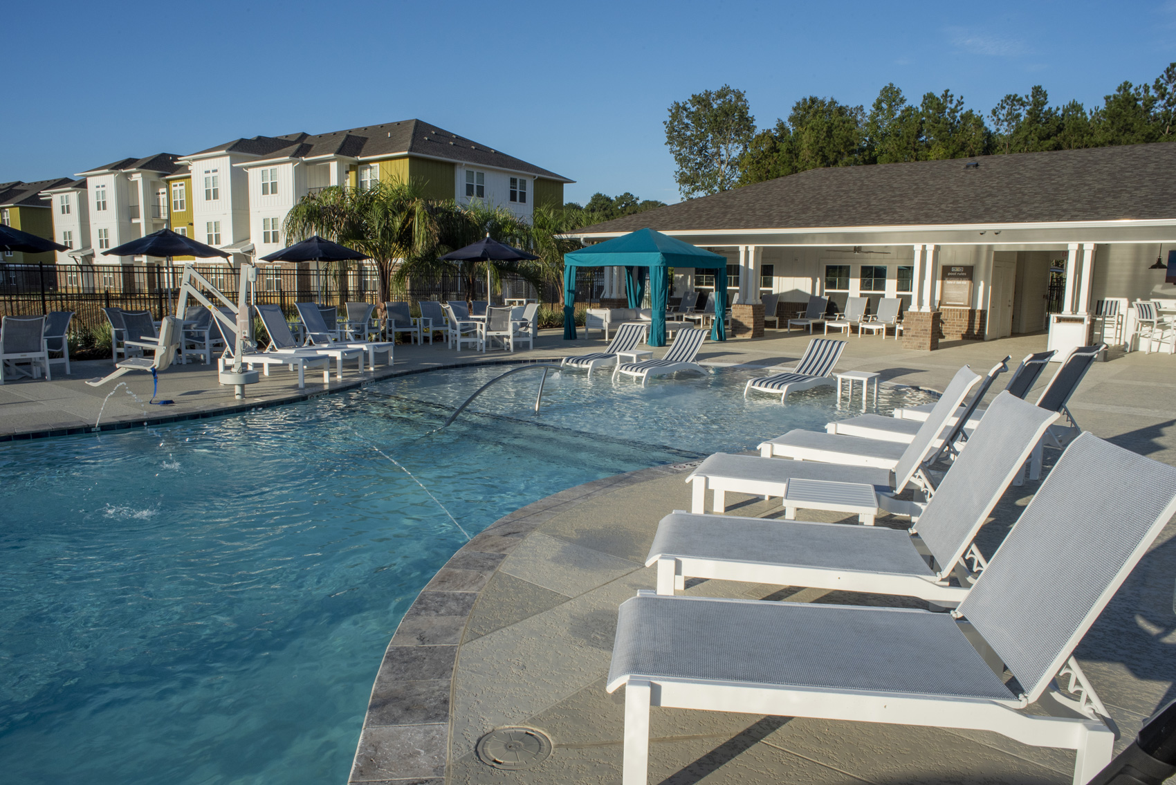 Poolside Lounge Furniture at The Palms at Juban Lakes Apartments in Denham Springs, Louisiana