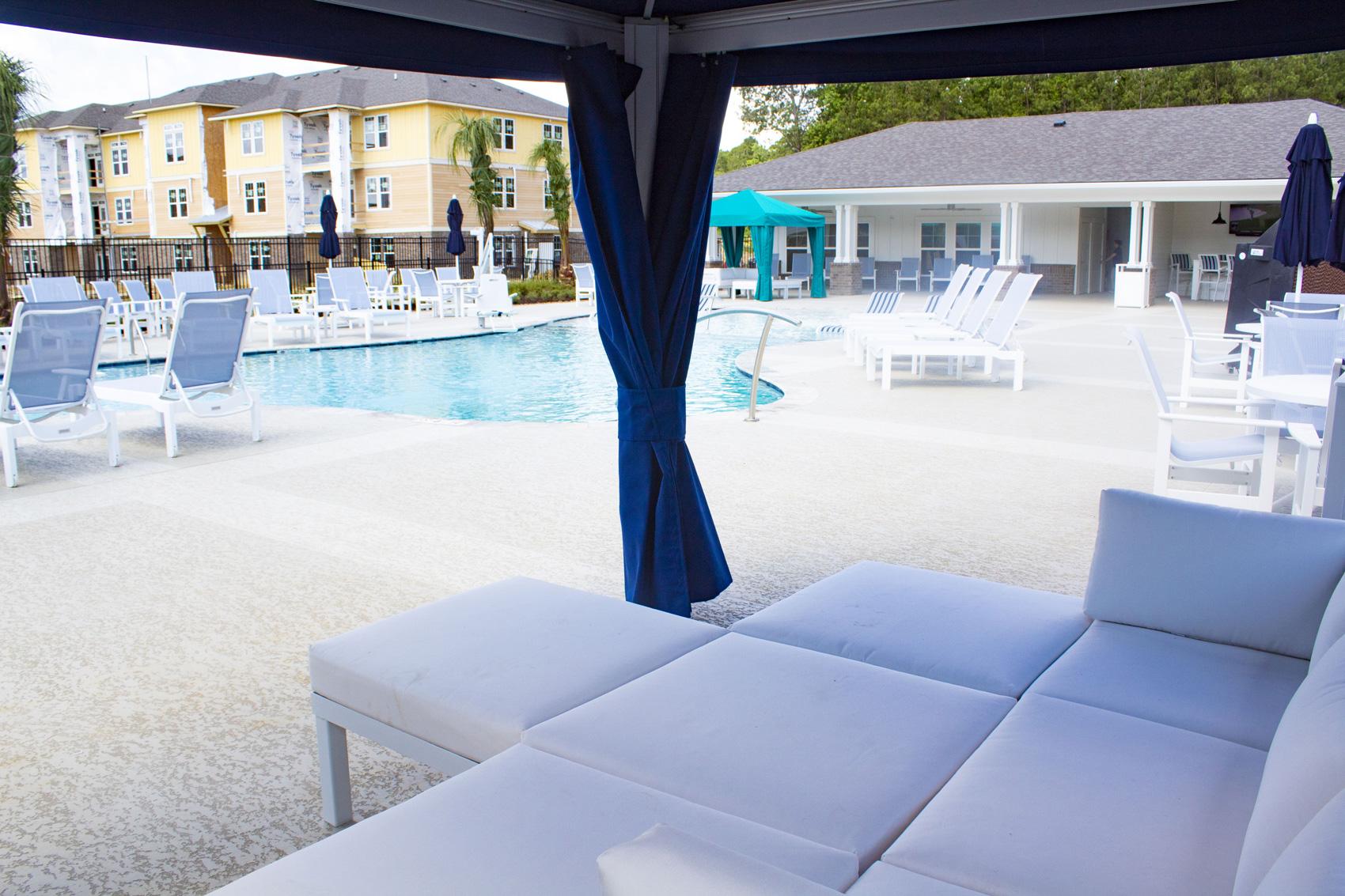 Shaded Poolside Areas at The Palms at Juban Lakes Apartments in Denham Springs, Louisiana