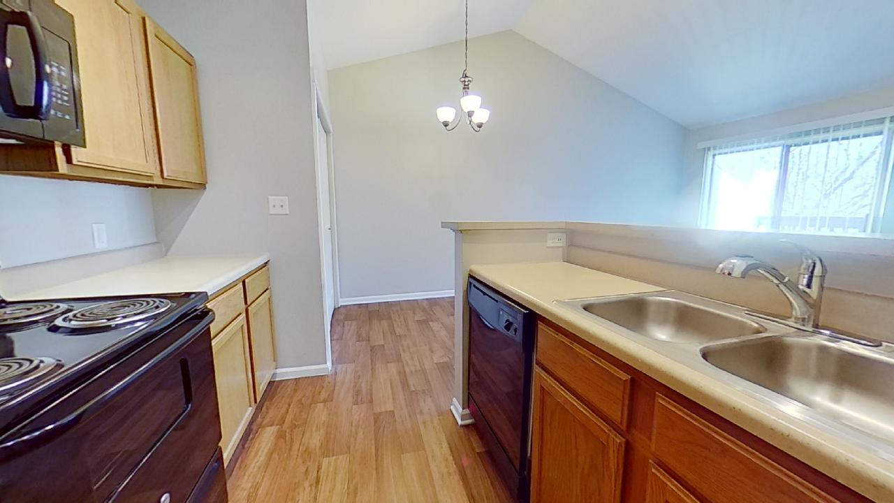Kitchen Cabinets at Patterson Place Apartments in Saint Louis, Missouri