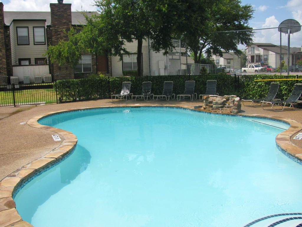 Resort-Style Swimming Pool at The Residences at Mesa Ridge Apartments in Garland, Texas