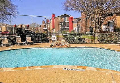 Sparkling Swimming Pool at The Residences at Mesa Ridge Apartments in Garland, Texas