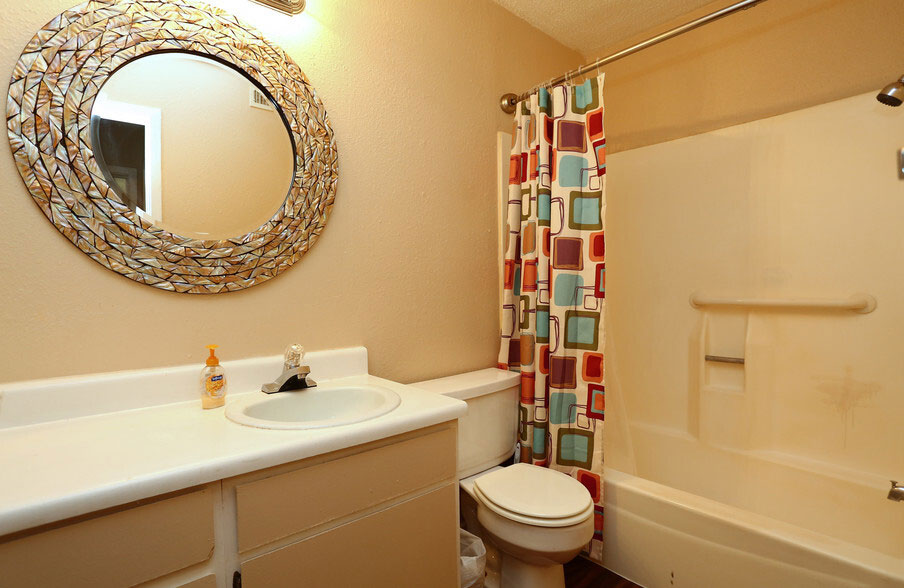 Bathtub and Shower at Peppertree Apartments in Odessa, Texas