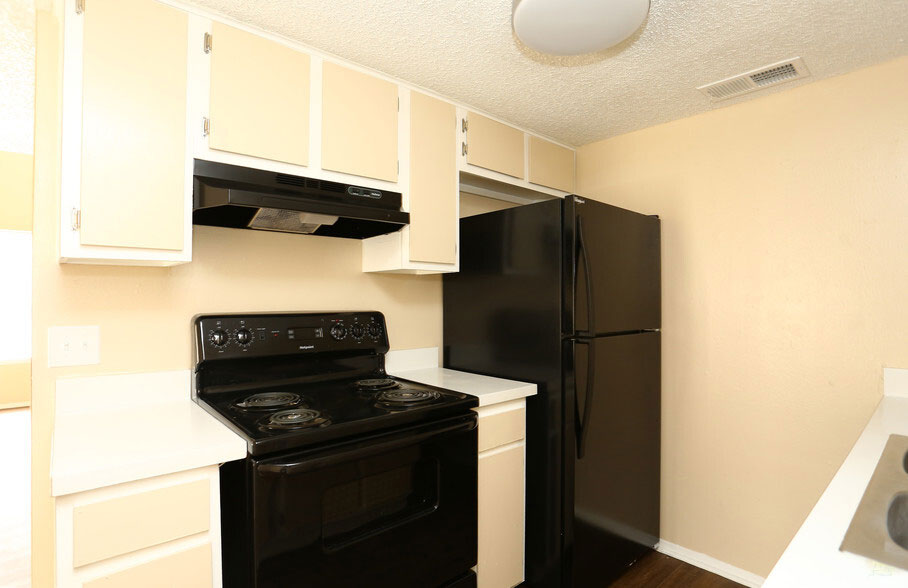 Black Kitchen Appliances at Peppertree Apartments in Odessa, Texas