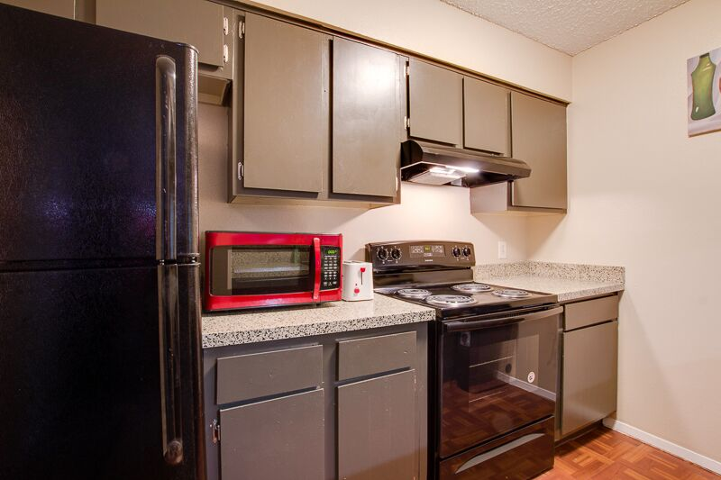 Refrigerator at Peppertree Apartments in Odessa, Texas