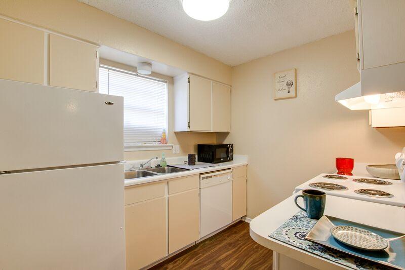 White Kitchen Appliances at Peppertree Apartments in Odessa, Texas