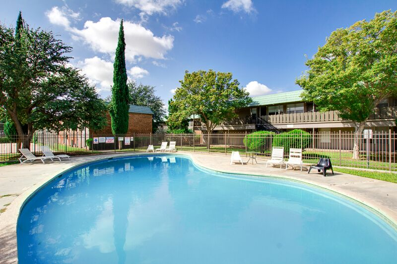 Sparkling Pool at Peppertree Apartments in Odessa, Texas