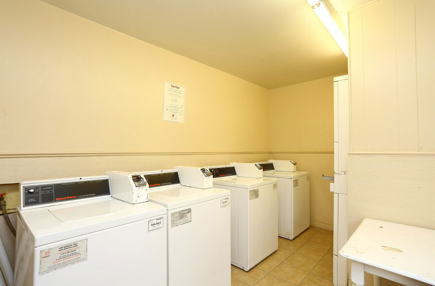 Laundry Center at Peppertree Apartments in Odessa, Texas