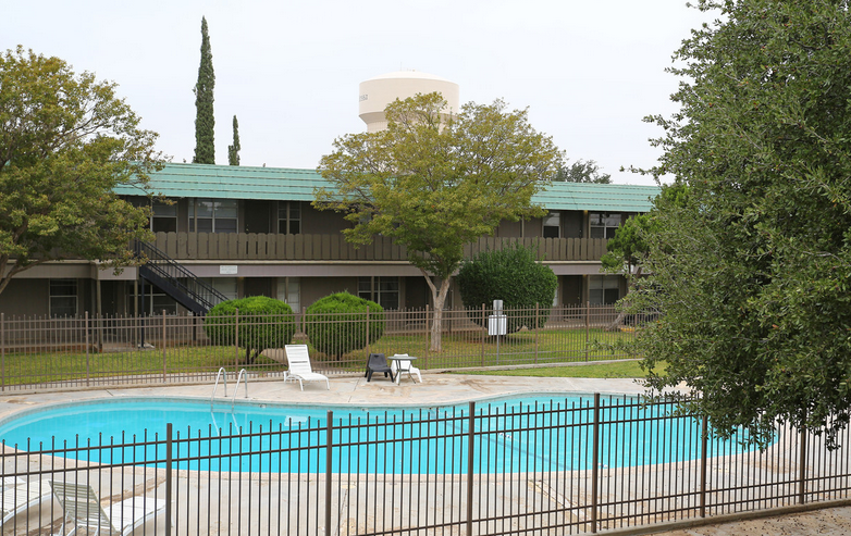 Pool with Sun Deck at Peppertree Apartments in Odessa, Texas