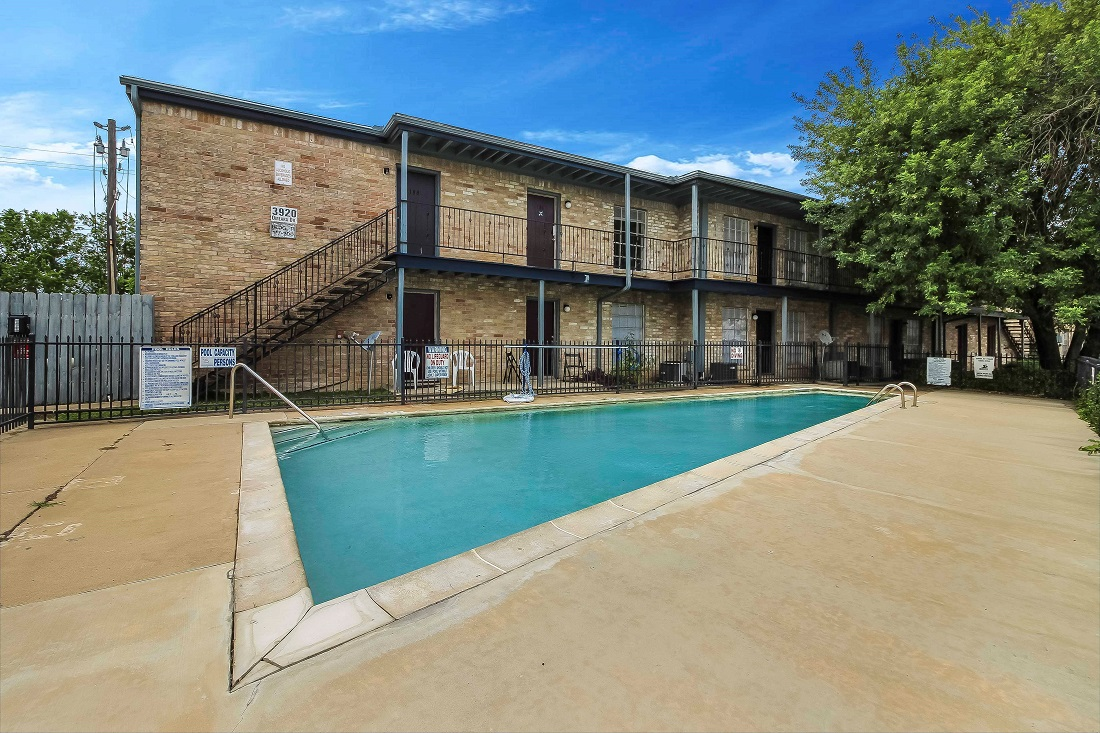 Pool with Lounge Area at Pine Terrace Apartments in Houston, Texas