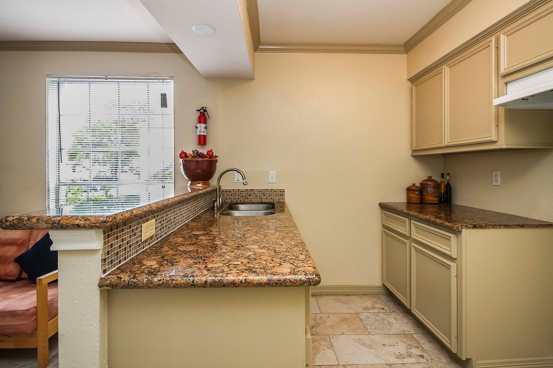 Spacious Kitchen Area at Pine Terrace Apartments in Houston, Texas