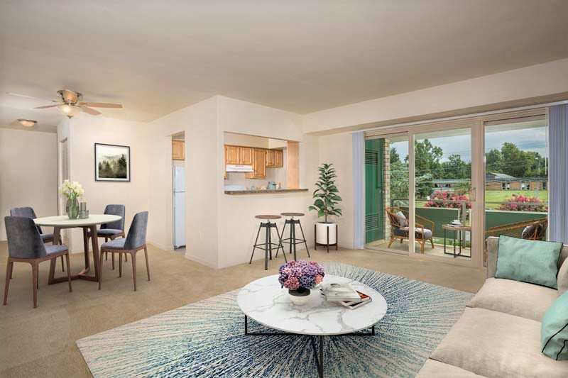 Spacious living and dining area at Pinewood Plaza Apartments in Fairfax, VA