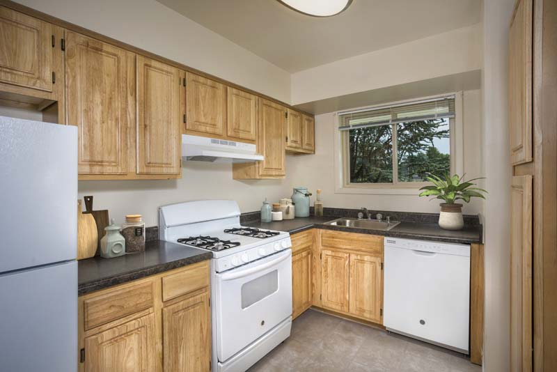 Fully-equipped kitchen at Pinewood Plaza Apartments in Fairfax, VA