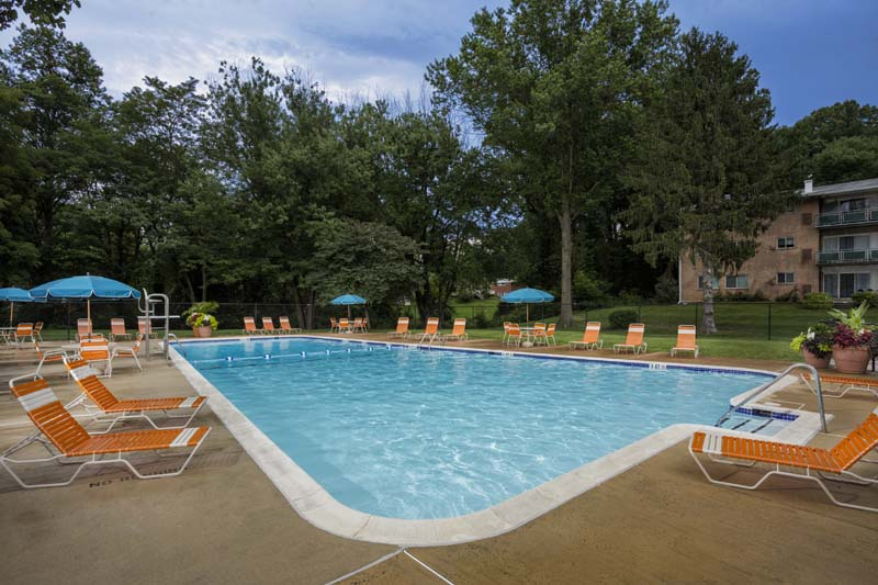 Relaxing swimming pool at Pinewood Plaza Apartments in Fairfax, VA