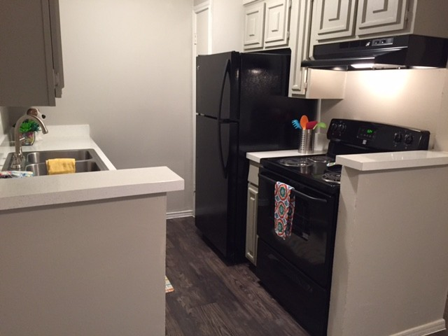 Kitchen w/ Ample Storage Space at The Point on Redmond Apartments in College Station, TX
