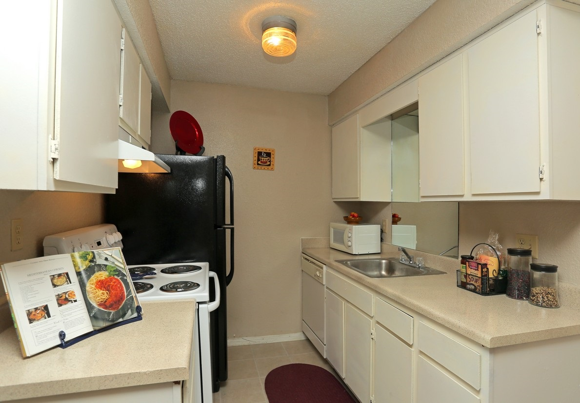 Kitchen Area at the Polo Club Apartments in Tulsa, OK