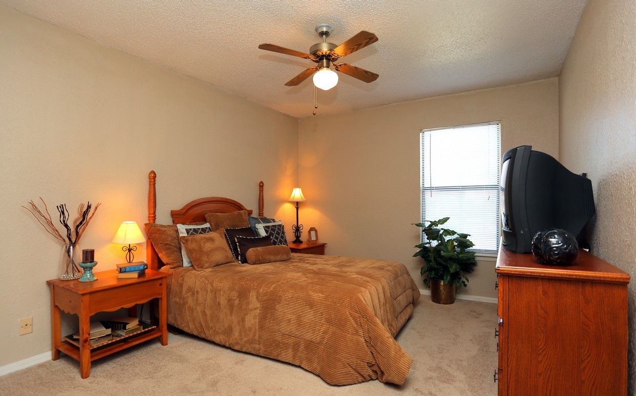 Bedroom at the Polo Club Apartments in Tulsa, OK
