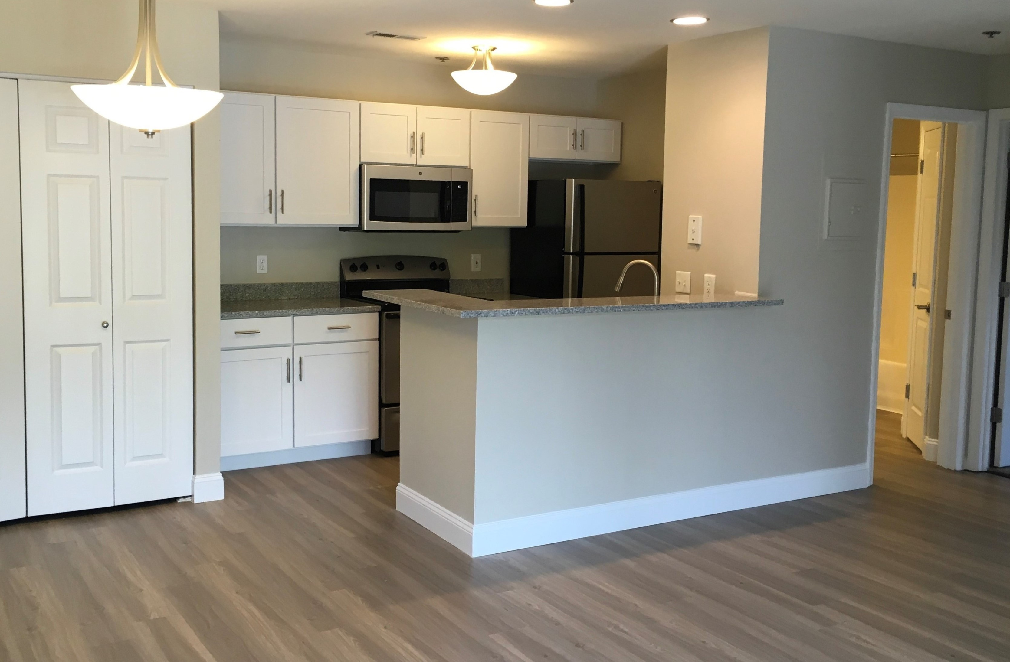 Deluxe Kitchen with white cabinets and granite counters