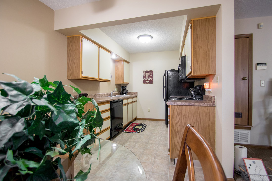 Apartments for Rent with Black Kitchen Appliances at Prairie West Apartments in Ames, IA