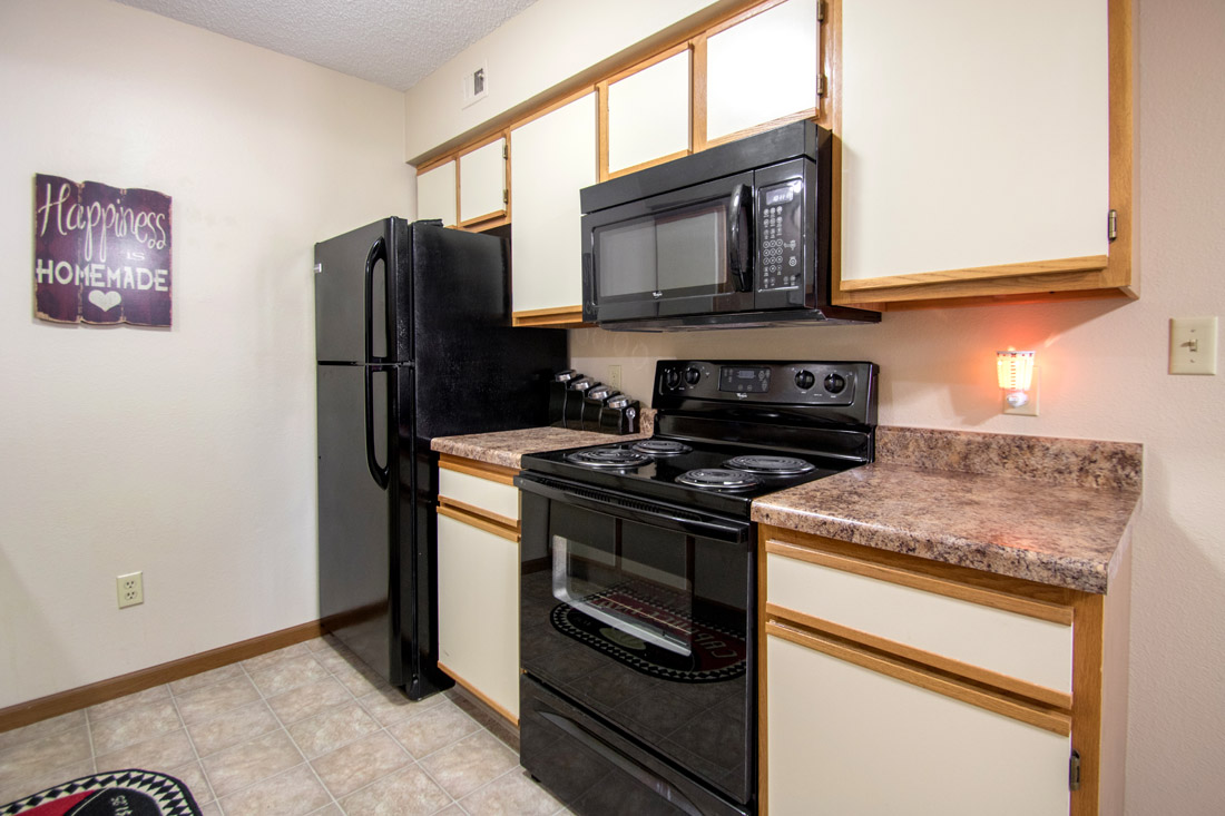 Ample Kitchen Cabinet Space at Prairie West Apartments in Ames, IA