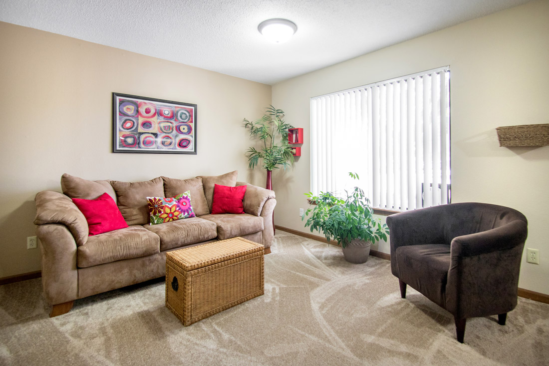 2 & 3 Bedroom Apartments for Rent with Carpeted Living Rooms at Prairie West in North Ames, IA.