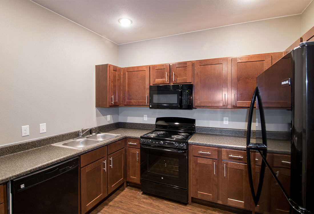Fully Equipped Kitchen at The Reserves at Preston Trails Apartments in Wolfforth, TX