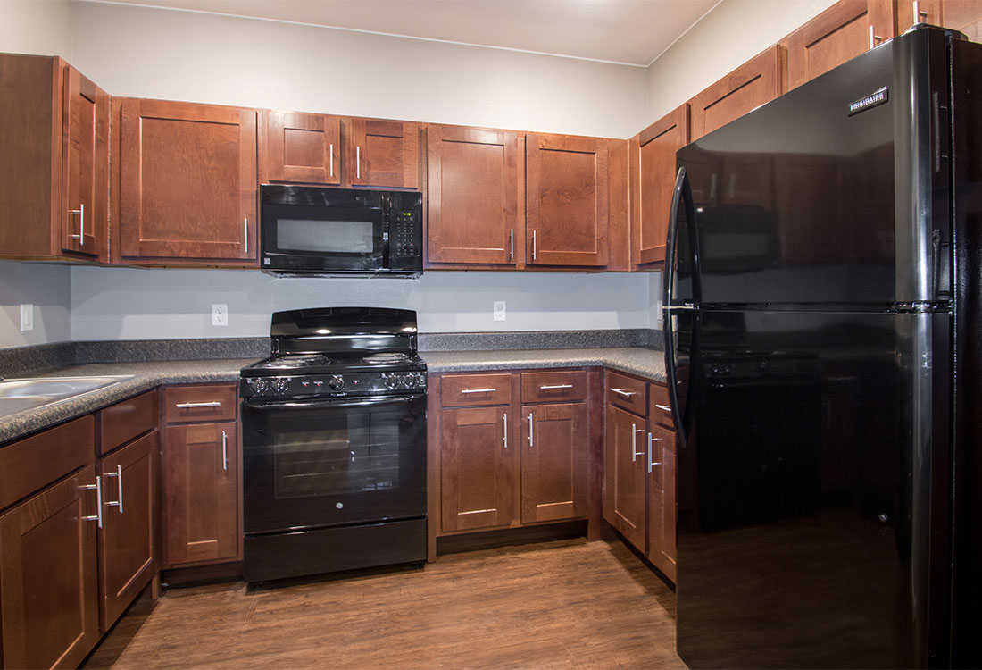 Black Kitchen Appliances at The Reserves at Preston Trails Apartments in Wolfforth, TX