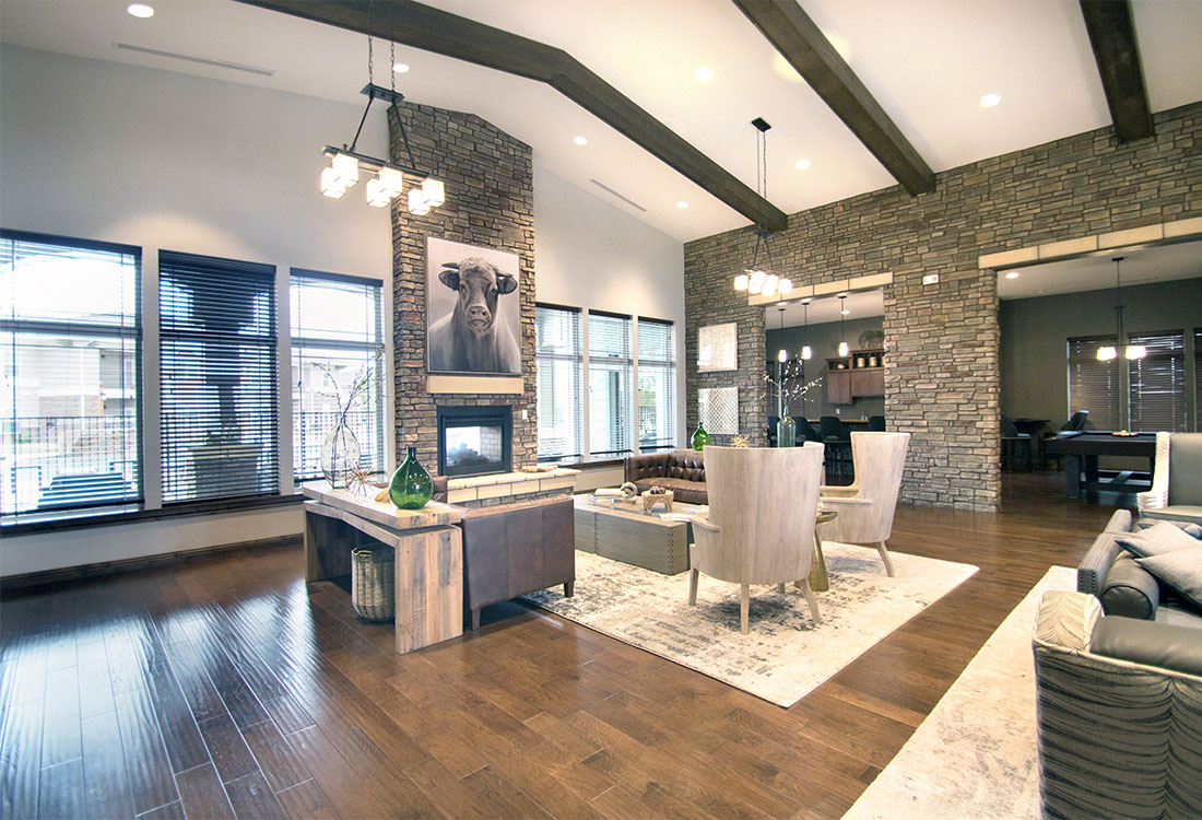 Clubhouse with Fireplace at The Reserves at Preston Trails Apartments in Wolfforth, TX