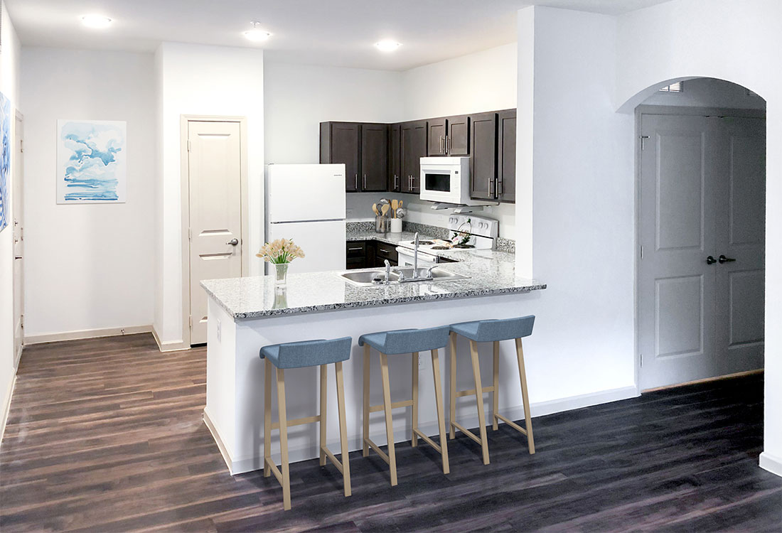 Kitchen with Granite Countertops at Provision at North Valentine Apartments in Hurst, Texas