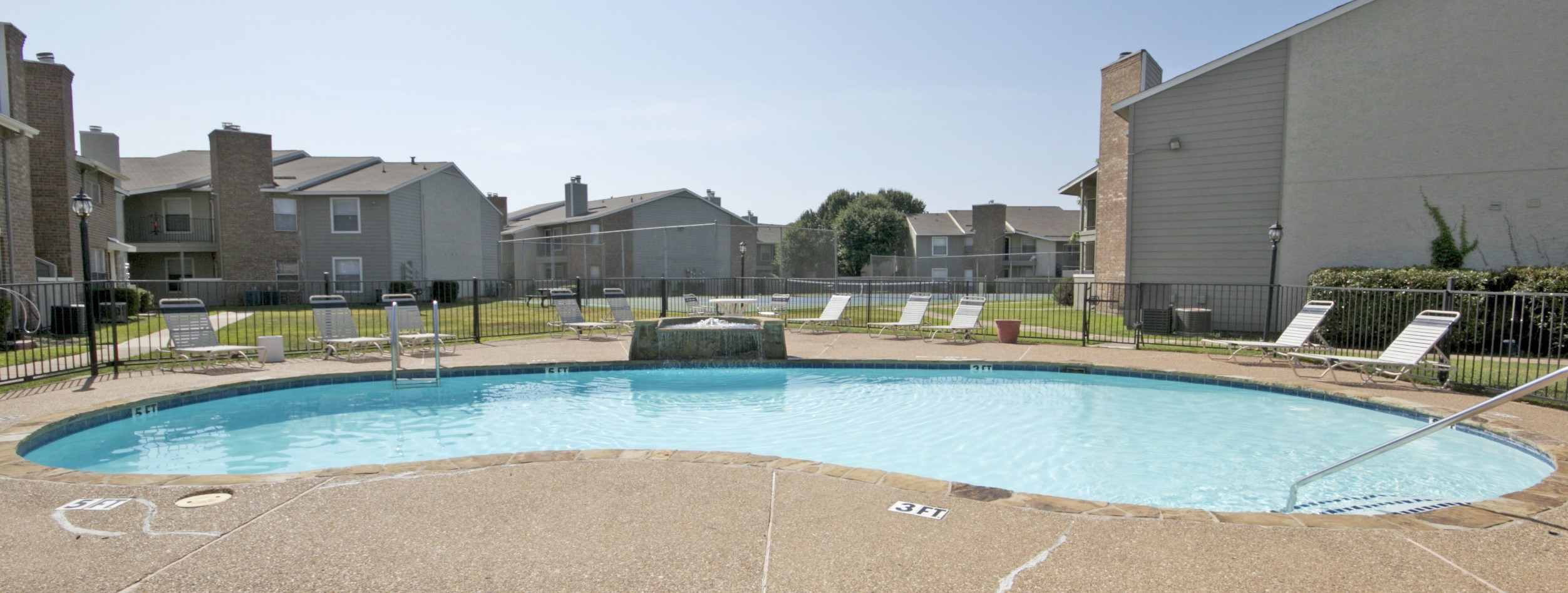 Relaxing Pool with Water Feature at Quail Ridge Apartments in Grand Prairie, Texas
