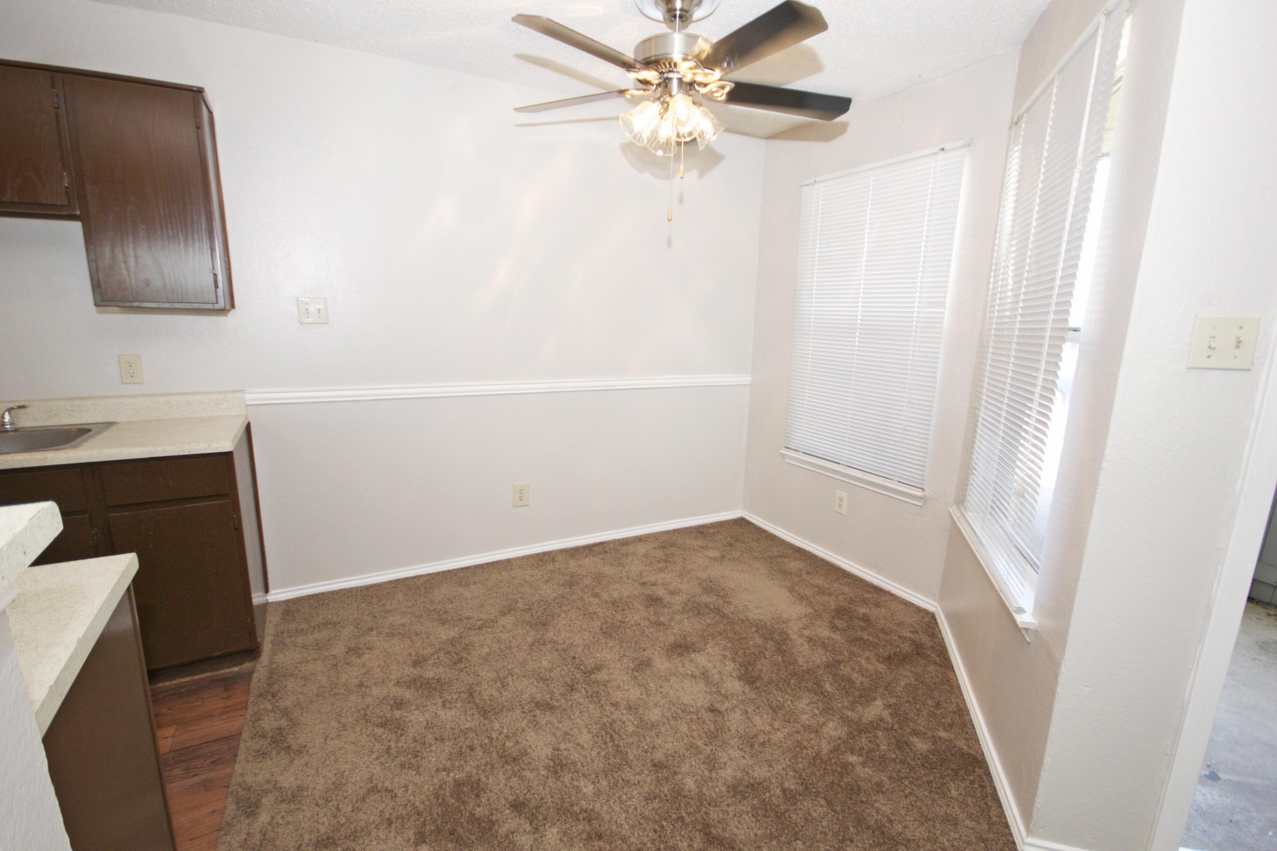 Separate Dining Area at Quail Ridge Apartments in Grand Prairie, Texas
