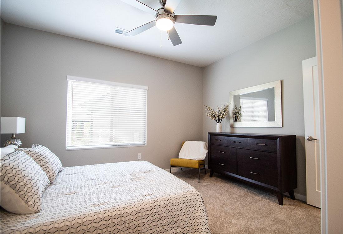 Bedroom with Plush Carpeting at Ravello 192 in Elkhorn, Nebraska