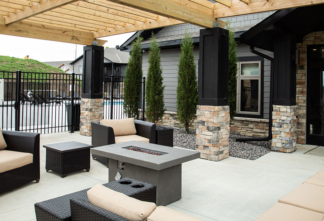 Patio with Fire Pit and Pergola Next to Outdoor Pool at Ravello 192 in Elkhorn, Nebraska