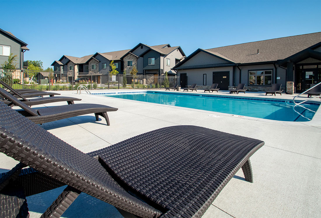 Beautiful Outdoor Pool with Comfortable Seating at Ravello 192 in Elkhorn, Nebraska