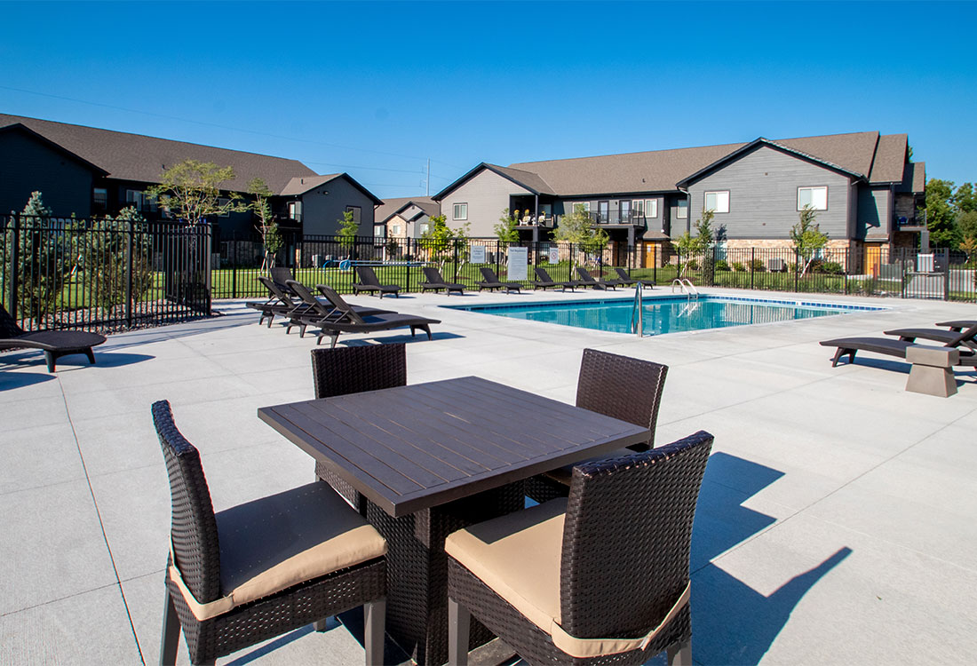 Beautiful Outdoor Pool with Seating at Ravello 192 in Elkhorn, Nebraska