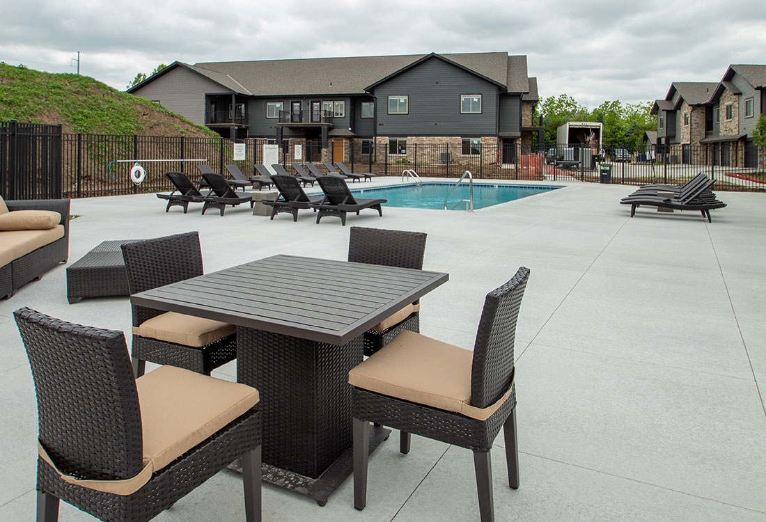 Outdoor Pool with Comfortable Seating at Ravello 192 in Elkhorn, Nebraska
