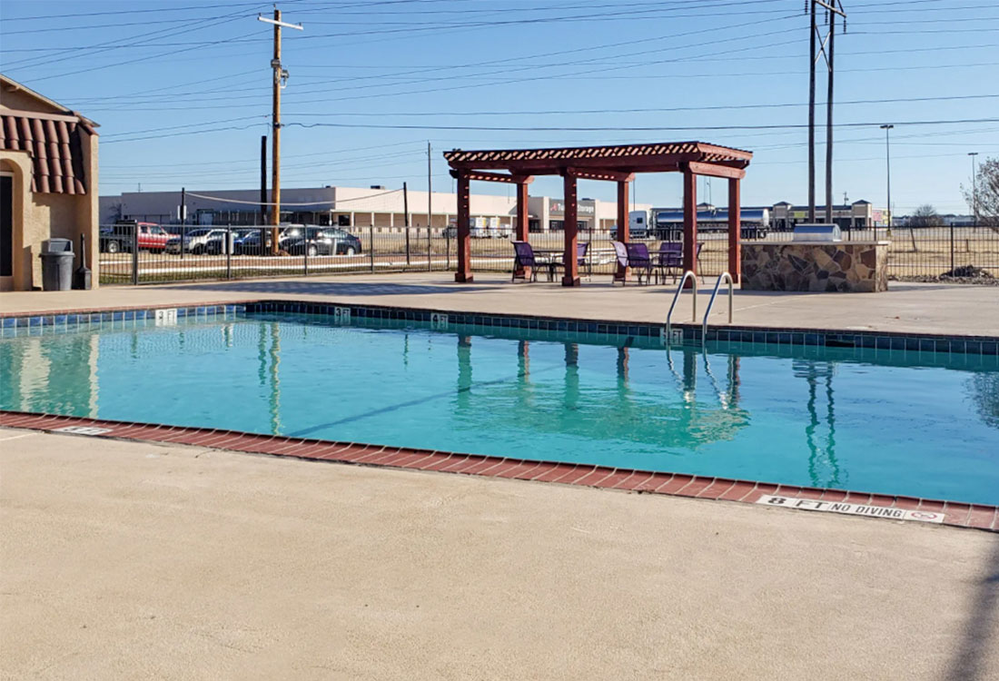 Swimming Pool with Patio at Riatta Ranch Apartments in Abilene, TX