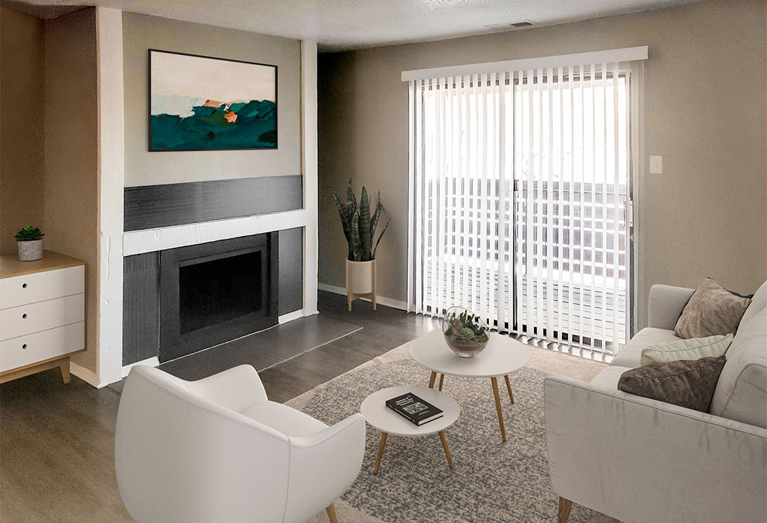 Apartments with Fireplaces and Wood Look Flooring at Riatta Ranch Apartments in Abilene, TX