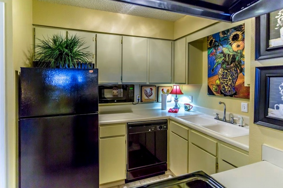 Refrigerator and Dishwasher at Ridgewood Apartments in Hot Springs, Arkansas