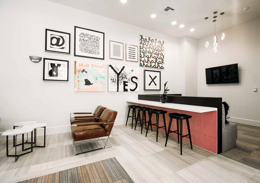TV Common Area with Plush, Modern Seating at Rivera Apartments in San Antonio, Texas
