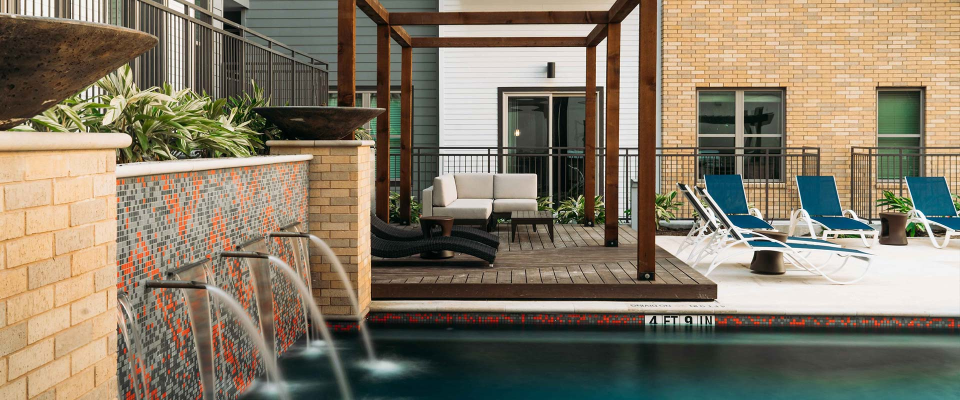 Outdoor Swimming Pool with Fountains at Rivera Apartments in San Antonio, Texas